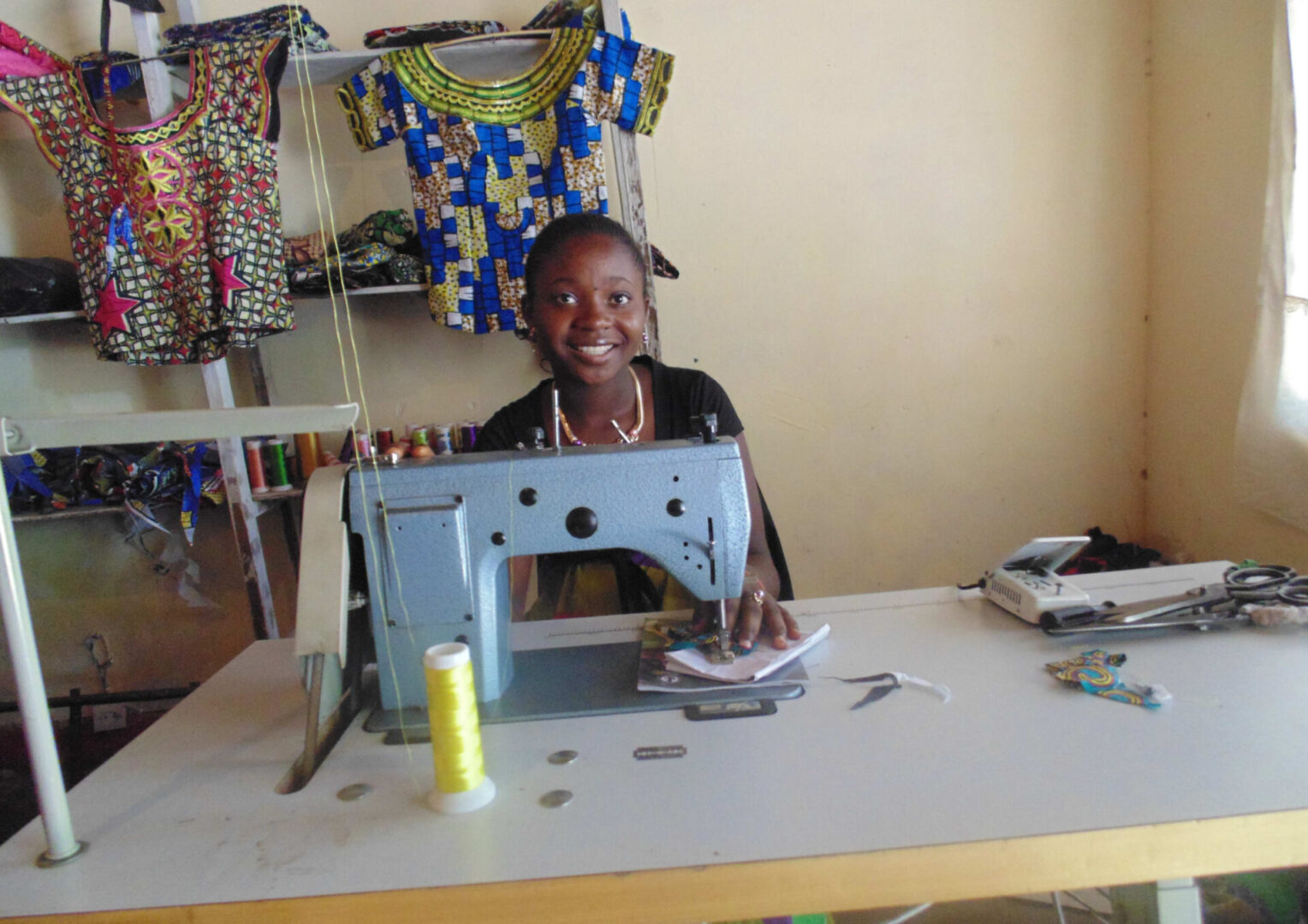 A woman working with a sewing machine